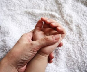 Mother holding kid's hand